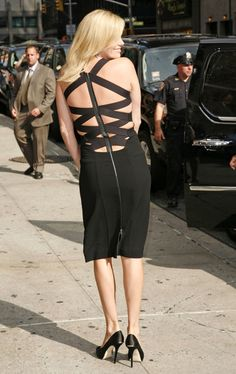 Charlize Theron Little Black Dress - This isn't your ordinary LBD! Charlize showed off an intricately strapped litle black dress for her visit to David Letterman.
