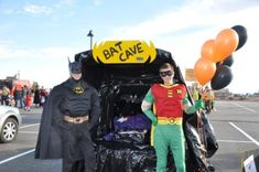 Batman & robin!!!!  trunk or treat very cool! @Sam McHardy McHardy Koehler that can be us but batgirl and supergirl instead :)