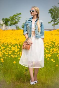 Pretty spring fashion!  Cropped top, skirt and denim jacket. Women's street style fashion for spring.