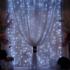 Christmas lights behind sheer curtains. I love this idea. Would look beautiful for a wedding too.