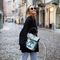 667ef8a63dc  natalyosmann wearing Furla Like sunglasses with her Furla Fenice bag. Click