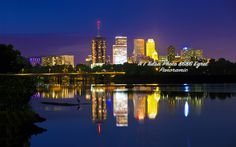 Tulsa Oklahoma panoramic picture taken from the River Parks pedestrian bridge late in the evening there is a egret that is visible on island if you look closely. Photo by John Shoemaker A1 Tulsa photo