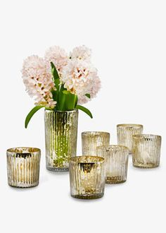 ANTIQUE SILVER RIBBED VOTIVE HOLDERS  THE FINISH ON THESE GLASS VOTIVE HOLDERS RESEMBLES ANTIQUE MERCURY GLASS. YOU MUST USE A LINER IF YOU PLAN TO USE THESE FOR FRESH FLOWER ARRANGEMENTS.