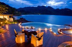 27-dining-by-round-infinity-pool-overlooking-ocean-cliffs.jpg