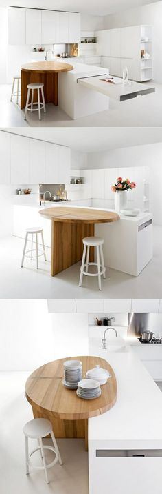 Wooden island table with white chair for white kitchen designs