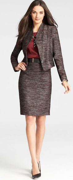 Why it works: A suit with a skirt of appropriate length, blouse, and heels of an appropriate height are perfect for the workplace.