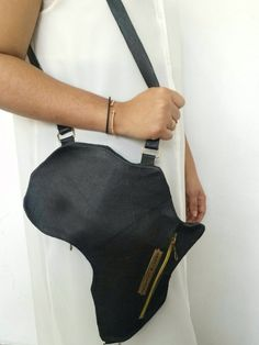 bd95e27c90 A Vintage Style leather bag designed in the shape of AFRICA. A unisex  collection inspired