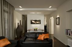 Apartments, Contemporary Apartment Interior Design Ideas For Your Inspiration: Black Sofa Combined With Orange Cushions In Wooden Floor