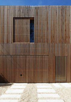 Maison 2G / Avenier Cornejo Architects Window screen slides behind main cladding.