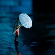 Woman with umbrella - urban street diorama - blue umbrella miniature photography - Fade