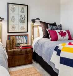twin bedroom done with a nod to all things Canadian including maple leaf toss cushion, Hudson Bay Blanket and Martha Sturdy brass candle holders.