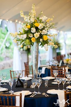 this one!  What do you think of this for tall arrangements?          Blue and yellow wedding  #coutureevents http://www.coutureeventssd.com