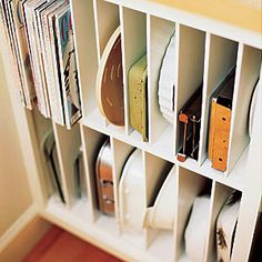 Go vertical Vertical dividers keep cake pans and casserole trays easy to see and retrieve--you avoid having to pull out the bottom one at risk of toppling all the others. Use any leftover slots for your go-to cookbooks or food magazines.