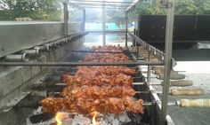 Delicious BBQ chicken thighs cooking on our Brazilian BBQ rotisserie