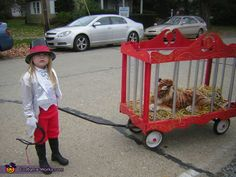 Sandy: Using a wagon I created a cage by using pvc pipe,painted it to look like a circus cage,added a stuffed animal.