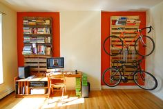 Pallets holding bikes and books. I like the red trim around the wood.