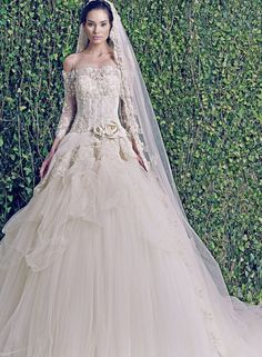 If you're into the high fashion bridal look, the 2015 bridal collection of Zuhair Murad wedding dresses is made for you. The gorgeous silhouettes, the intricate Swarovski-beaded bodices, the luxurious embroidery and laces are unmatched. Take a look!