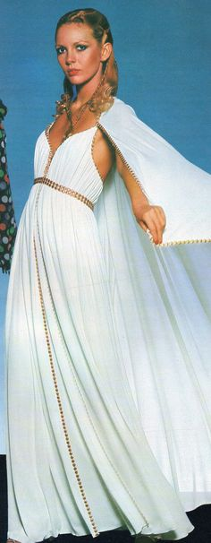 Schiaparelli Haute Couture- 1977  White crepe Grecian empire dress with gold edged details and attached cape.  L'officiel USA Spring 1977