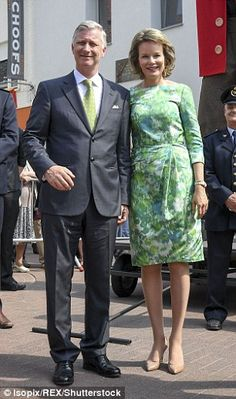 The queen accompanied husband King Philippe...