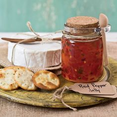 This Red Pepper Jelly is perfect served with crackers as an appetizer for all your holiday parties, or spread on a sandwich for a tasty desk lunch.