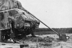 The attempt to replace track at heavy German Maus tank. 1945.