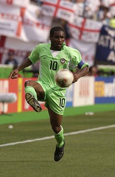 Jay Jay Okocha of Nigeria on the ball during the World Cup Group F match between Nigeria and England at the Osaka Nagai Stadium in Osaka Japan on. God Of Football, World Football, Football Kits, Nike Football, Football Reference, Lionel Messi Wallpapers, World Cup Groups, Football Wallpaper, Best Player