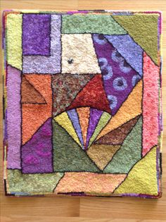 Crazy quilt hooked rug, hooked by Toni Jette