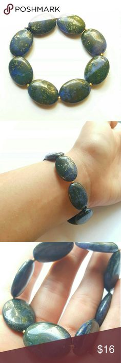 NEW!! Unique Smooth Stone Stretch Bracelet Im actually not sure if this is a gemstone or not, it looks like it could be or just smoothed stones. Theres colors of green, blue, and gold it appears. If you know what this stone is please let me know! Creation Central Jewelry Bracelets