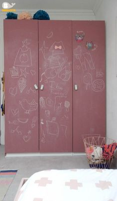 pink chalkboard doors of Pax with leather pulls are ideal for a kid_s space