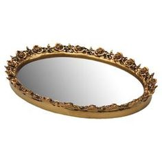 Mirrored tray with an antiqued gold finish.           Product: Tray  Construction Material: Resin and mirrored glass  Color: Antique gold      Features:    Oval shapeGreat item for the bedroom dresser or bathroom counter    Dimensions:  1.42 H x 10.25 W x 12.25 D   Cleaning and Care: Wipe with a clean soft damp cloth. Do not use harsh chemicals or abrasives.
