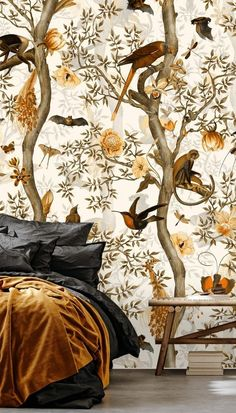 Create a cozy bedroom with these beautiful fall colors. By focussing on burnt oranges and golden yellows, this bedroom color palette is all you'll need this fall. Charming floral patterns and cute birds in this wallpaper also offer those cozy fall vibes. Would you go for this idea in your bedroom?