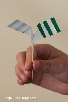 Here's a fun science experiment for kids with a simple helicopter style twirler. These toothpick twirlers spin as they fall! Here's how to make one: Gather your supplies: paper, scissors, toothpicks, and tape. You might also want markers for decorating. Cut a strip of paper and fold it in half like this: Then fold like …