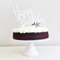 chocolate guinness cake topped with hand cut paper haappy birthday topper + stars [recipe via nigella lawson]