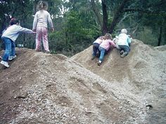 PILE IT UP. Soil or sand piles are an excellent opportunity for children to learn about differences in landscape and concepts of elevation, as well as an excellent tool for some energy-releasing obstacle races.