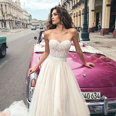 Instagram media by youyourwedding - Strapless with dreamy floaty skirt #Repost @julievinobridal ・・・ Havana f/w 2018 Allegra gown #julievino #havana2018 #newcollection #weddingdress #couture #wedding #nycbridalweek #weddingday #tulle #silk #empireline #mermaid #plungeneck #lowback #shoulderdetail #blush #white #weddingdress #wedding #bridetobe #lace #ballgown #veil #yourdayyourway #youandyourwedding