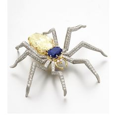 The Spider, Designed by Michael Stadther, Made by Robert Underhill The realistically modelled insect set with a cushion-shaped sapphire weighing 6.36 carats and an oval diamond of yellow color weighing 21.23 carats, the legs and eyes set with a total of 404 round diamonds altogether weighing 12.73 carats, mounted in 18 karat gold and platinum.