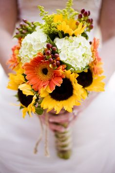 White hydrangea, orange gerbera, sunflowers and all tied with twine.