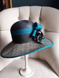 Grey and teal hat trimmed in silk.
