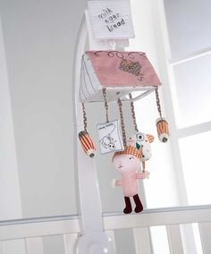 Mamas and Papas Scrapbook Mobile! Is in our baby girl's crib!