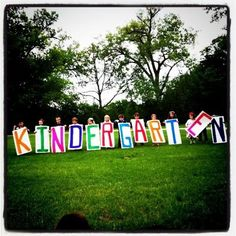 Picture of kids holding big letters