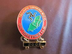2006 ISLE OF MAN TT RACES TRIUMPH OWNERS MEET OFFICIAL LAPEL PIN BADGE PIN BACK