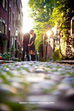 Engagement Photo: Low angle with sunlight behind, City Streets.