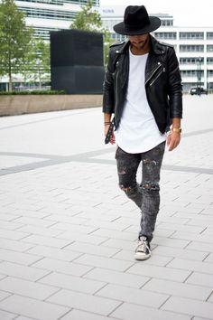 Shop this look on Lookastic:  https://lookastic.com/men/looks/biker-jacket-crew-neck-t-shirt-skinny-jeans-low-top-sneakers-hat-watch/13147  — Black Wool Hat  — White Crew-neck T-shirt  — Black Leather Biker Jacket  — Gold Watch  — Charcoal Ripped Skinny Jeans  — Charcoal Low Top Sneakers