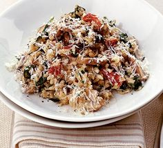 Mushroom & Spinach Risotto  http://www.bbcgoodfood.com/recipes/3245/mushroom-and-spinach-risotto