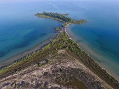 This Hidden Beach In Michigan Will Take You A Million Miles Away From It All Fisherman's Island State Park Michigan Vacations, Michigan Travel, Lake Michigan, Michigan Accent, Camping Michigan, Charlevoix Michigan, Michigan State Parks, Detroit Michigan, Wisconsin
