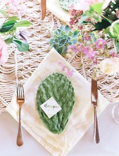 Channel the beauty of the dessert with cactus table settings.