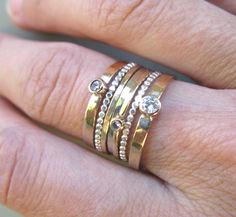 A good mixture of everything!  {3} bezel set diamond rings in 14k gold (specify white or yellow)  {2} 14k gold, 18 gauge bands and {2} sterling silver bead rings. A total of {7} sparkly rings!!!!