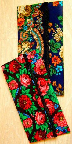 Clutches with bright Russian floral patterns.