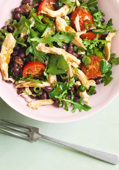 This colorful chicken, black bean and arugula salad somehow manages to be full of assertive flavors, yet not too closely aligned with any particular cuisine