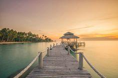 Wooded bridge pier between sunset in Phuket.